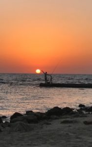 fisherman at sunset pic